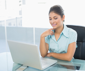 Business Woman at Laptop, Payroll Solutions in Annapolis, Baltimore, DC
