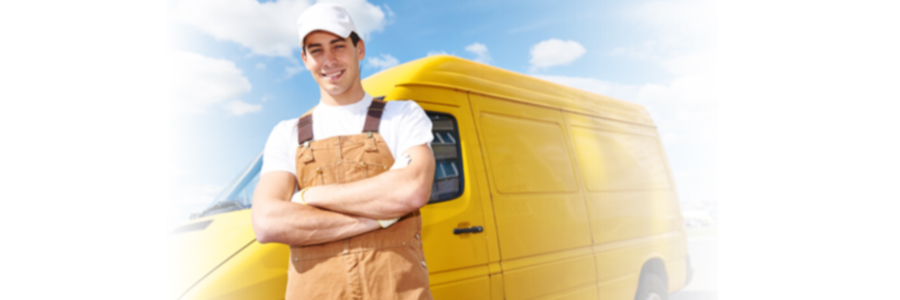 Smiling man in front of a delivery van