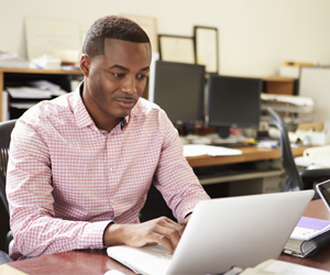 Businessman working on computer, Tax Resolution in Annapolis, Baltimore, DC